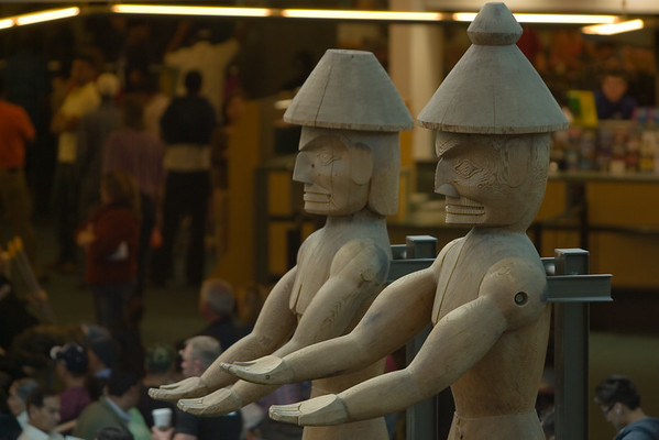 Statues stand ready to collect the airport tax