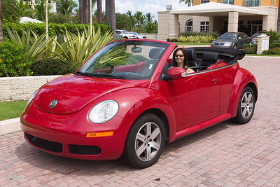 The convertible Beetle seems made for her