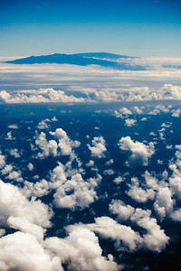 The Big Island comes into view as we head out over the clouds