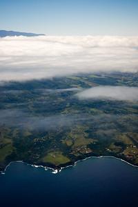 Kealii Point and the Uaoa Bay (Haleakala pokes through the clouds)