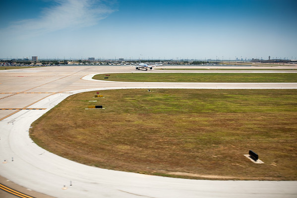 An American Airlines Boeing 767 moves into position for takeoff on a parallel runway as our plane is just seconds from landing