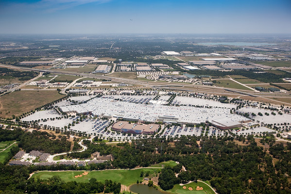 I can see a distant aircraft on approach to the east of Grapevine Mills shopping mall
