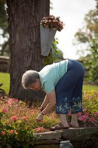 Aunt Barbi works in the garden