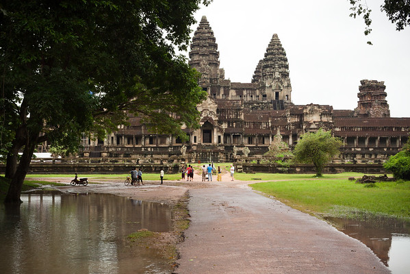 It is not raining...and the middle section of the path to Angkor Wat remains mostly dry.  As we approach the temple, Chen points me to a spot where a tree blocks the scaffolding.