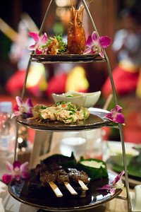 Valerie snaps a shot of her main course...the Angkor Wat Tower: Mekong lobster, spicy chicken soup, stir-fried crab legs, bbq beef skewers marinated with lemongrass and tamarind peanut crumbs, black wild rice and fried garlic jasmine rice (Photo by Valerie)