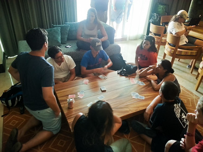 Playing cards until it is time to leave