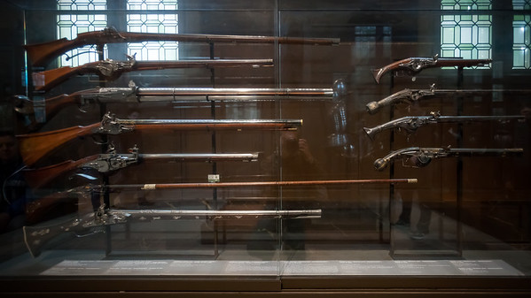Early rifles...a bit hard to photograph due to the reflective cases and bright windows