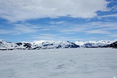 View at Uranostinden (Uranos peak) across the lak Tyin. / Utsikt på Uranostinden over sjøen Tyin.