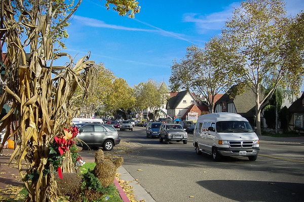 A constant stream of cars travel through town