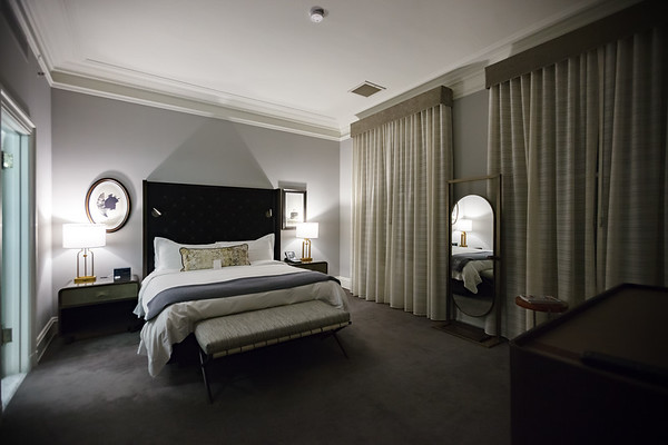 The bedroom looks huge thanks in part to the high ceiling