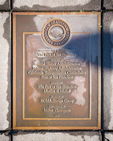 Plaque on the ground near Gate B