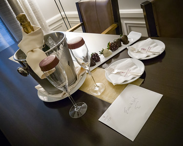 Valerie's friend Phuong has a plate of chocolate covered strawberries and champagne delivered to our room
