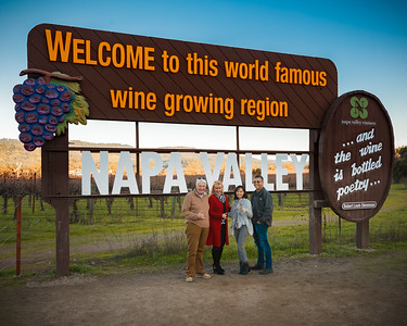Tom, Peggy, Valerie, and I pose by the Welcome to Napa Valley sign near Calistoga