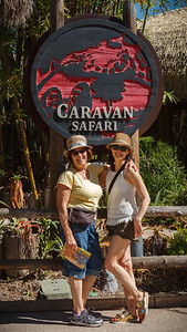 Mom and Valerie pose in front of the Caravan Safari sign