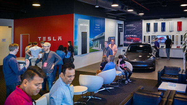 A showroom serves as waiting area for the tour.  Many of the tour-goers likely already own a Tesla (owners and their guests can tour the factory once a year), but this may be the first time many have seen a Model 3 in person.