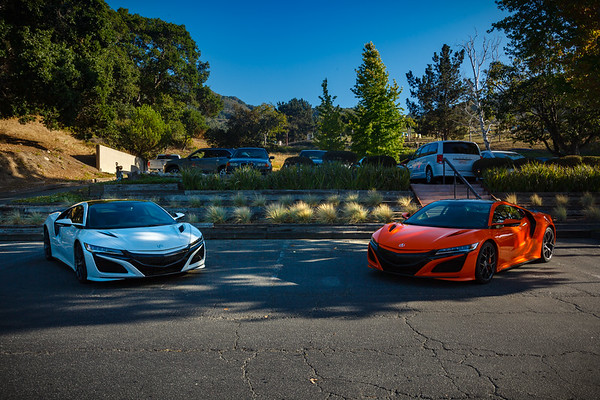 Casino White and Thermal Orange NSXs greet the shuttles as they arrive at the Carmel Valley Ranch Clubhouse