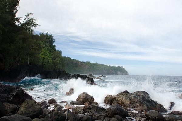 More waves crash against the rocks