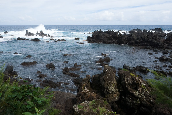 In some places, the waves crash in tall plumes as they collide with the rocks