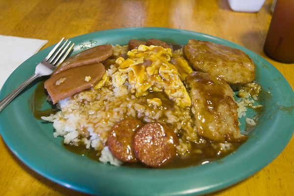 The Big Mok is their variation of Loco Moco, the local breakfast.  This coronary on a plate consists of  sausage patties (instead of hamburger), Portuguese Sausage, Spam, scrambled eggs, and rice smothered in brown gravy...salty and heavy, but something that must be tried at least once