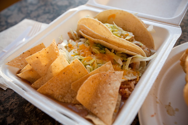I figure it is finally time to try their fish tacos.  I order combo #1, which comes with two tacos (in this case, fish), rice, beans, and chips. Not nearly as good as Wahoos, but still tasty.