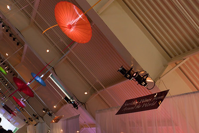 Upside-down parasols soften and filter the color of the overhead lights...each wine and food station has signage