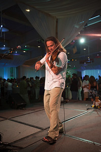 Violinist Aaron Meyer takes the stage while the other performers are on their break
