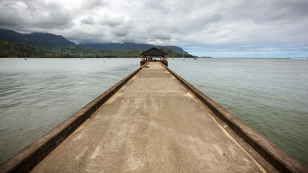 I step on to the Hanalei Pier