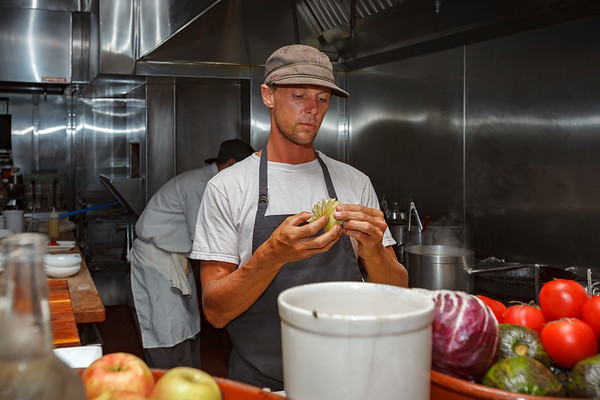 Our cook gets to work on our first course...he presents a sliced apple like a card dealer