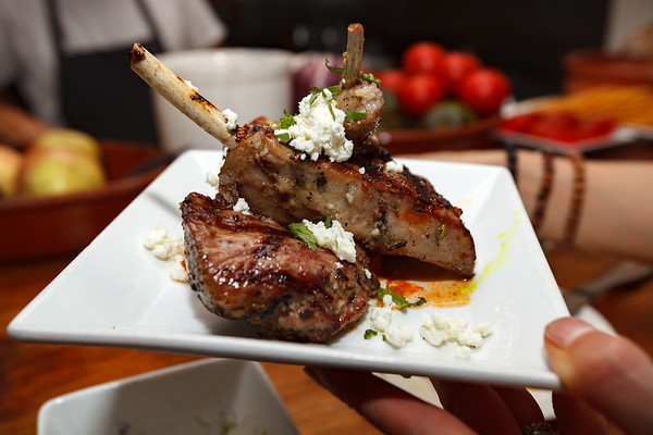 Grilled Lamb Riblettes with roasted cherry tomatoes, curry oil, and French feta cheese...so tasty!