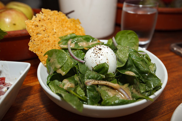 Spinach Salad with a soft poached egg, parmesan crisp, honey mustard and truffle vinaigrette