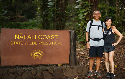 We pose for a photo by the Napali Coast sign before heading up the trail