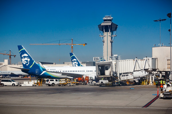 Looking back at the jet bridge as the LAX Control Tower lines up with our now vacant gate