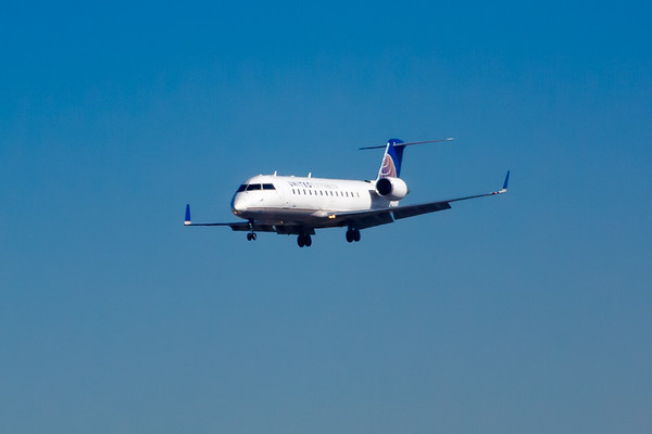A United Express flight lands as our plane prepares for takeoff