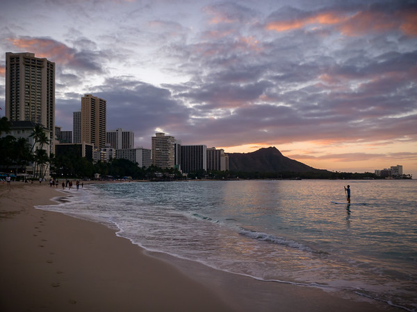 I continue west, running on the sand of Waikiki Beach as I try to figure exactly where the sun is going to rise.  A lone stand up paddleboarder enjoys the calm water in Waikiki Bay...