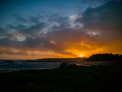 I try to find a better vantage point as the sun rises over Kuilima Cove and Kaihalulu Bay