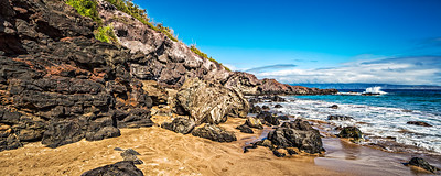 A panorama of Mokuleia Bay, Maui using three images.  Lots of sea turtles and interesting lava formations in this area. Off to the left we rescued a sea turtle who managed to wedge himself into the rocks during low tide. The turtle could barely get his head above water for air so we decided to intervene and not wait to see if high tide would free him. Another fellow assisted me by pushing on the sea turtle from underwater while I pushed from above, being mindful of the gentle sea creature's powerful jaws. After a few minutes we freed the turtle, who took off like a bat out of hell.