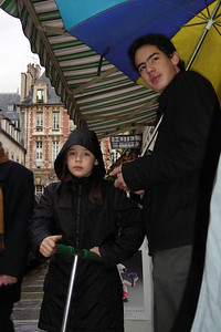 Max holds an umbrella