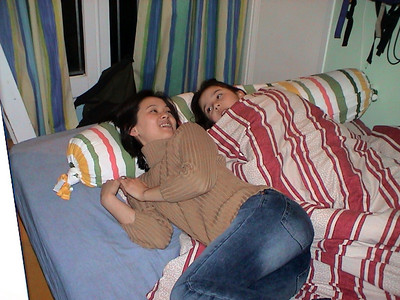 Back at the apartment, Val and Charline nap together