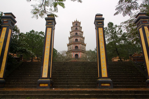 First stop is the Thien Mu Pagoda. Due to the rainy weather, I have wrapped my camera in one of the hotel's plastic raincoats and I take shots from under our tour guide's umbrella