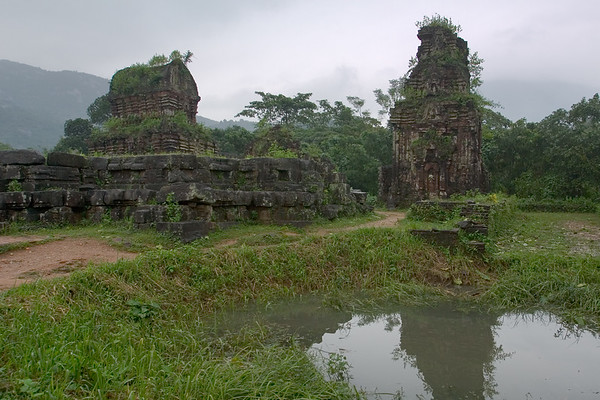 Pools like these have been left by B52 bomb blasts (dating back to the Vietnam War). This particular crater reflects one of the surviving temple structures at My Son