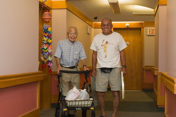 Time to say sayonara to Ojiichan (and soon to dad). Ojiichan follows us out so he can get started on his rounds. Note the bags in his walker...he appears to be re-gifting his birthday treats!