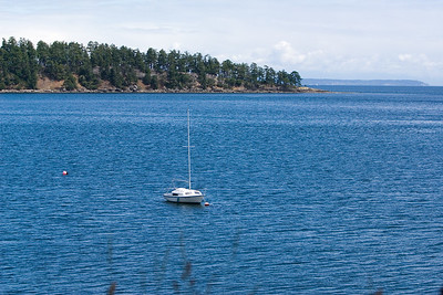 A sailboat is anchored in the bay