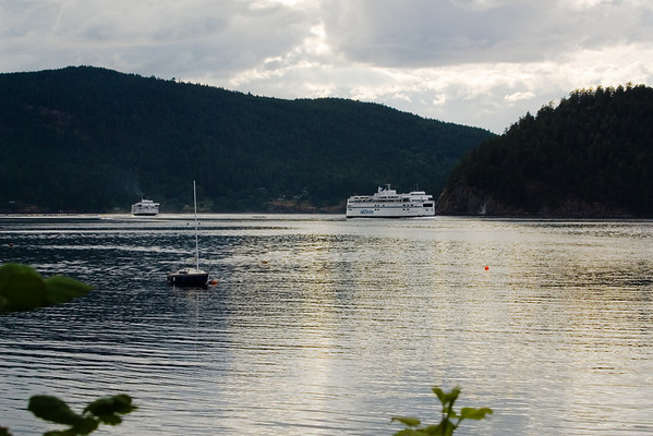 A pair of BC Ferries sail by