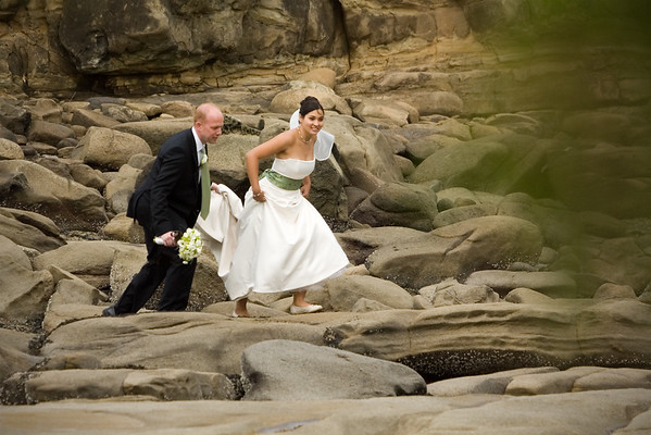 Jeff and Angella carefully traverse back along the rocks