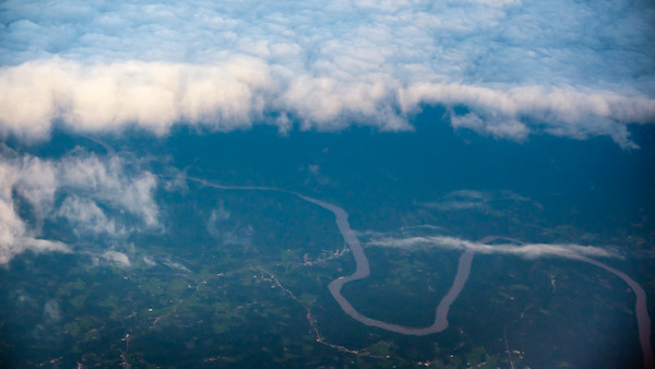 On final approach to Siem Reap, I catch a glimpse of a river through a rare break in the clouds...perhaps the Mekong?