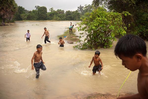 Kids take advantage of the rising water