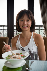 Valerie with her daily bowl of Phở Tai