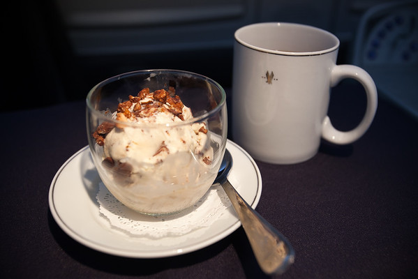 For dessert, we are served coffee and a large scoop of Haagen Daz ice cream topped with crumbled Heath Bar.  Delish!