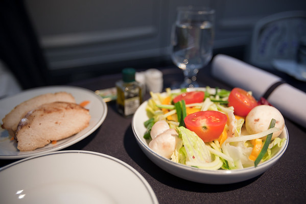 An hour into the flight, our flight's first meal is served...in courses.  First course is a tasty grilled chicken salad.  Very fresh.