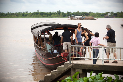 DAY 14 (continued from Ho Chi Minh City 2.0) - Valerie, Michel, and I take a day trip to the Mekong Delta, boarding a boat (not the one pictured) in Cái Bè